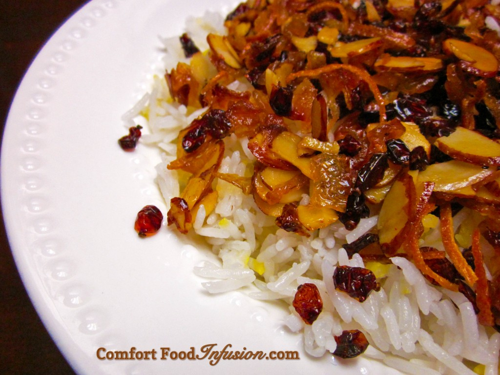 Barberry Rice Pilaf (Zereshk Polo). Small sour berries combined with caramelized onion, almond, orange and saffron, atop basmati rice.