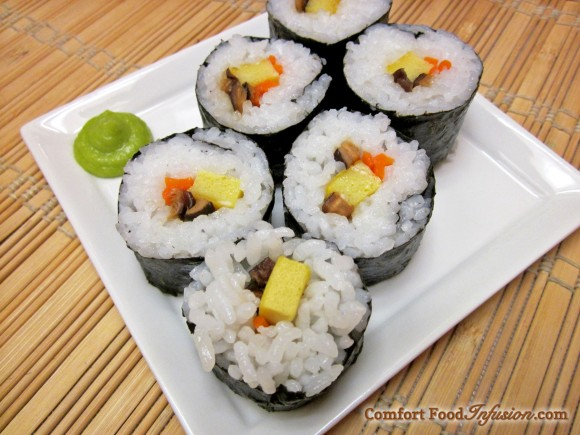 Sushi rolls filled with egg (tamagoyaki), carrots and shitake mushrooms.